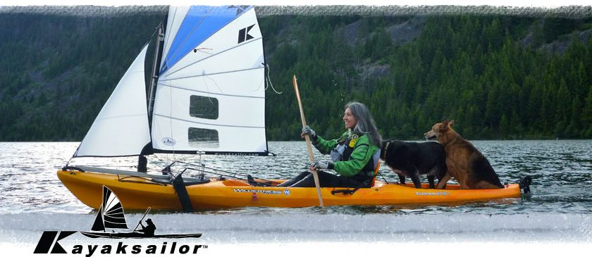 Kayak sailing with our two dogs